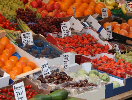A Colourful Display of Fruit on a Greengrocers Stall. photo