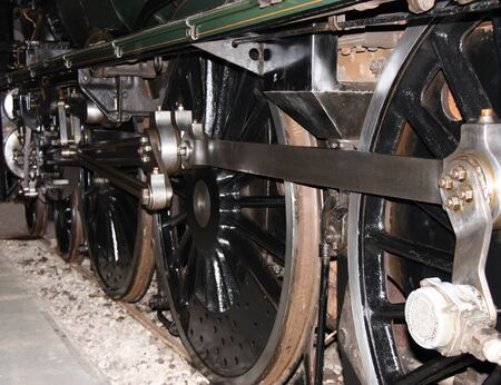 The Wheels of a Large Powerful Steam Train Engine. photo
