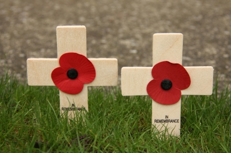 Two Remembrance Day Wooden Crosses with Poppys.