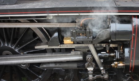 The Rods and Pistons on a Powerful Steam Locomotive. photo