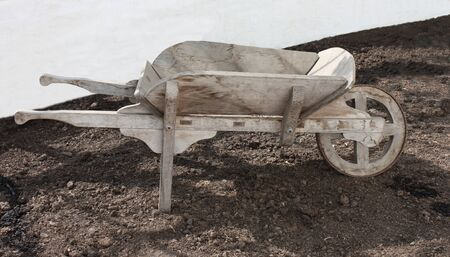A Traditional Vintage All Wood Gardeners Wheelbarrow. photo