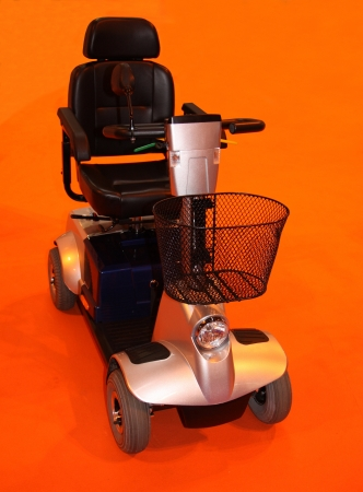 An Electric Four Wheeled Motorised Disability Scooter. photo