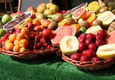 A Colourful Market Stall Display of Fresh Fruit. photo
