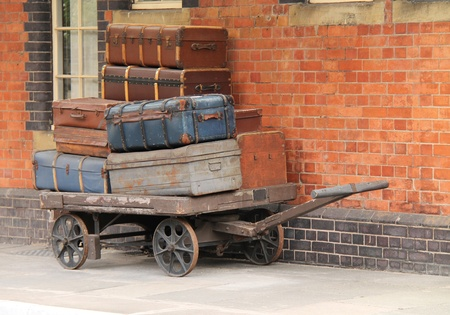 A Traditional Train Station Trolley Holding Suitcases.
