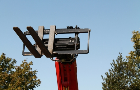 reach truck: The Lifting Forks of a Mechanical Cherry Picker.