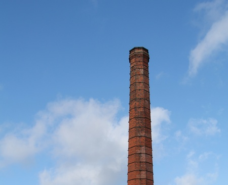 tall chimney: A Traditional Brick Built Tall Industrial Chimney. Stock Photo