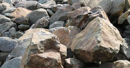 Large Rocks at the Edge of a Seaside Beach. photo