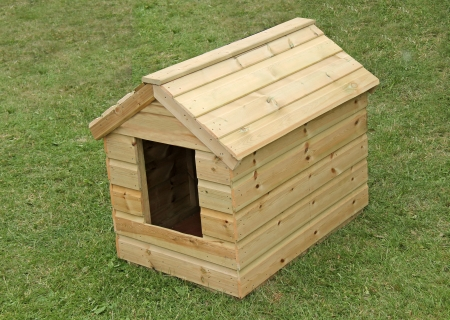 A Brand New Wooden Dog Kennel on a Grass Lawn  photo