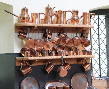 A Display of Traditional Kitchen Copper Saucepans