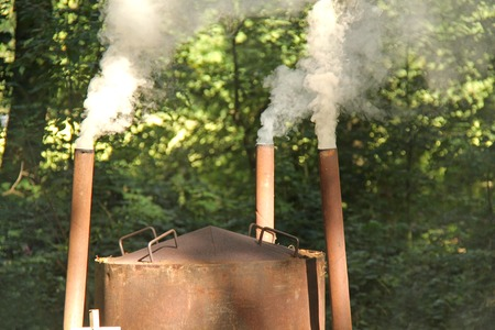 wood burner: The Smoking Chimneys of a Charcoal Making Oven
