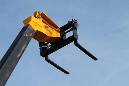 reach truck: The Forks of a Telescopic Lifting Cherry Picker  Stock Photo