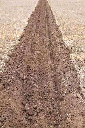 furrow: A Deep Ploughed Furrow on a Farmers Field