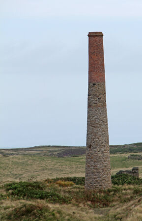 mine site: An Industrial Chimney at a Cornish Tin Mine Site  Stock Photo