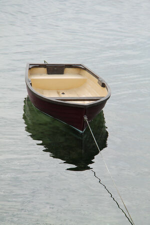 tethered: A Small Rowing Boat Tethered to a Rope