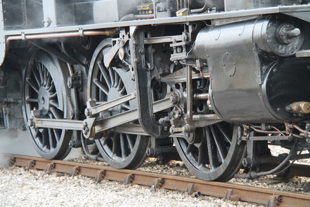 The Large Wheels of a Vintage Steam Train Engine  photo