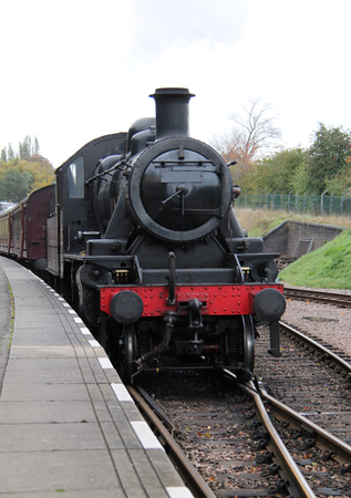 A Classic Steam Locomotive Pulling a Vintage Train