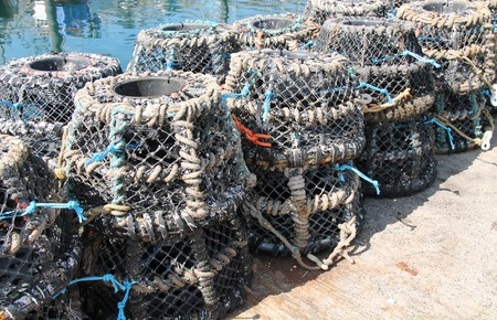 crab pots: A Stack of Traditional Lobster Pots on a Harbour Wall