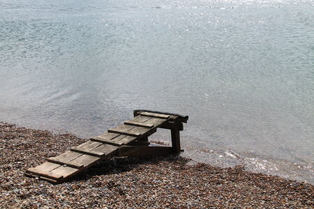 staging: A Wooden Landing Stage from a Beach to a Boat.