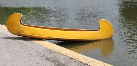 fibreglass: A Bright Yellow Fibre Glass Canoe Boat.