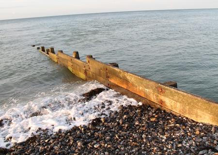 groyne: A Wooden Coastal Groyne on a Stony Beach.