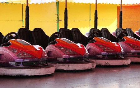 fun fair: The Riding Cars on a Fun Fair Dodgem Attraction.
