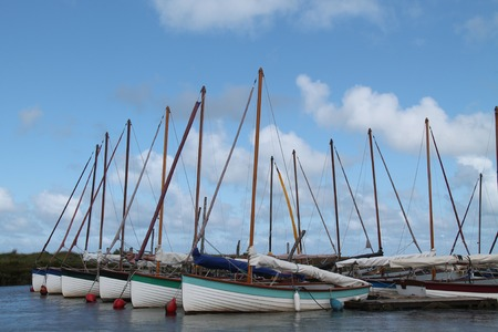 dinghies: A Collection of Sailing Dinghies Moored at a Jetty. Stock Photo