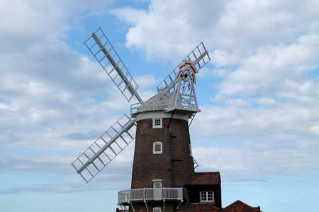 traditional windmill: A Brick Built Traditional Windmill with Wooden Sails. Stock Photo