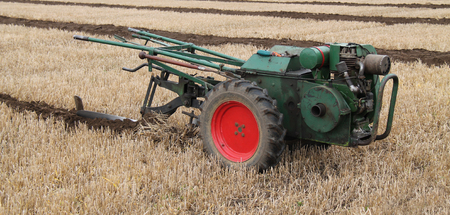 plough machine: A Hand Steered Vintage Agricultural Farming Plough.