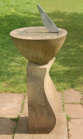 plinth: A Classic Stone Sundial on a Garden Plinth. Stock Photo