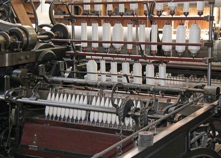 textile machine: The Bobbins and Threads on a Classic Textile Machine.
