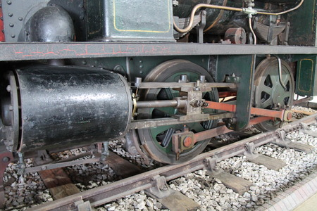 round rods: The Wheels and Piston of a Vintage Steam Train Engine.
