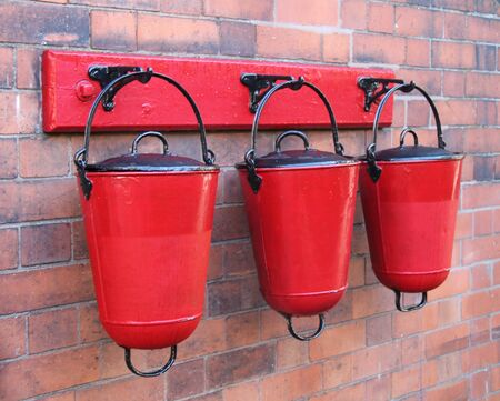 red metal: Three Wall Mounted Red Metal Fire Sand Buckets.