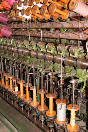 textile machine: The Cogs and Bobbins of a Vintage Textile Machine. Stock Photo