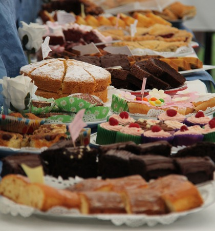 eating cake: A Display of Fresh Homemade Cakes for Sale. Stock Photo