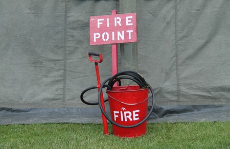stirrup: A Vintage Fire Point with a Bucket Hose and Pump.