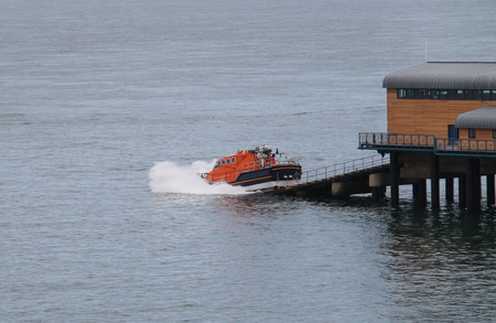 slipway: The Launch of a Rescue Lifeboat From a Pier Slipway.