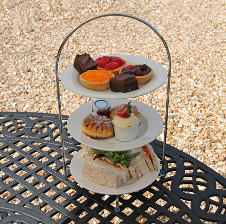 tiered: A Classic Afternoon Tea Served on a Tiered Plate. Stock Photo