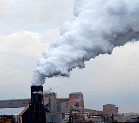 tall chimney: Thick Smoke Belching from an Industrial Chimney.