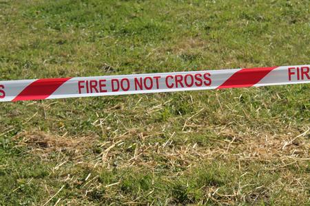do not cross: A Do Not Cross Fire Service Warning Tape. Stock Photo