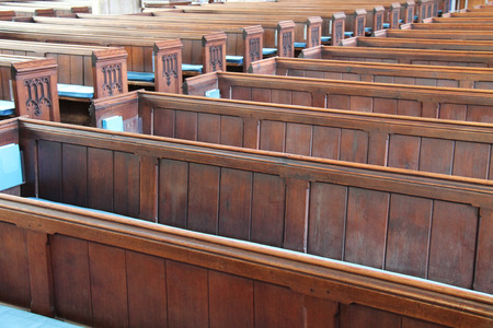 worship service: Rows of Wooden Pew Seats in a Traditional Church. Stock Photo