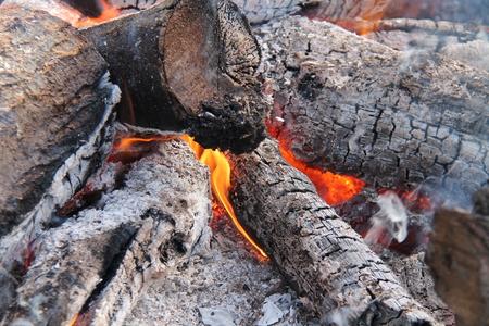 log fire: The Hot Embers of a Burning Wood Log Fire.