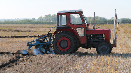 ploughing: A Vintage Tractor at a Farm Ploughing Demonstration. Stock Photo