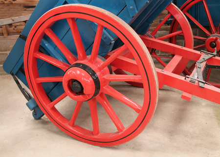 old wood farm wagon: The Wooden Wheel of a Vintage Horse Drawn Cart.