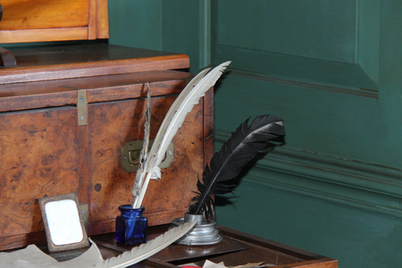 feather quill: A Vintage Writing Desk with Feather Quill Ink Pens.