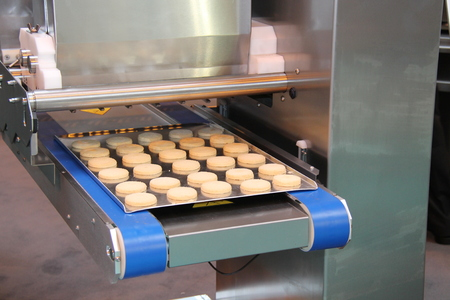 A Cookie Biscuit Making Food Processing Machine. Stock Photo