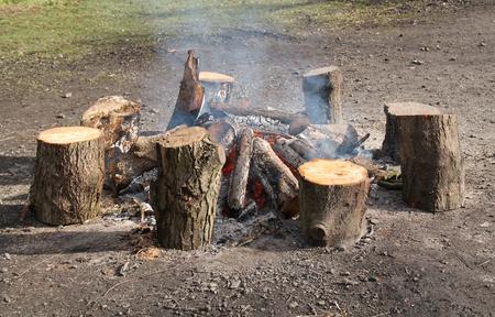 log fire: A Beautiful Warming Outdoor Wood Log Fire. Stock Photo