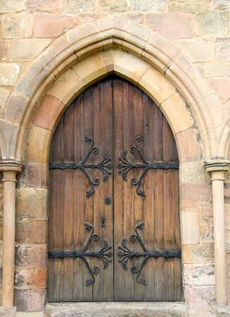 architectural tradition: A Heavy Wooden Door Entrance to an Historic Building. Stock Photo
