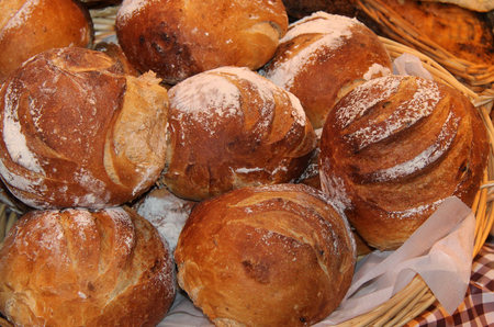 crusty: A Display of Freshly Baked Crusty Bread Loaves. Stock Photo