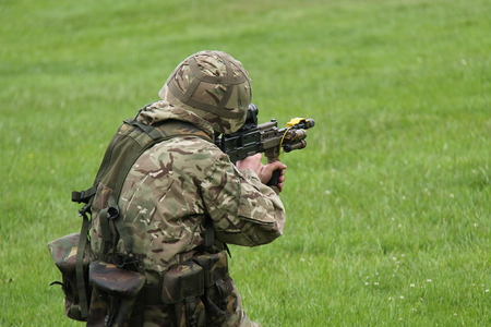 blanks: An Army Soldier Firing a Gun on a Training Exercise.