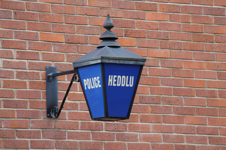 constabulary: An Outdoor Blue Sign at a Welsh Police Station. Stock Photo